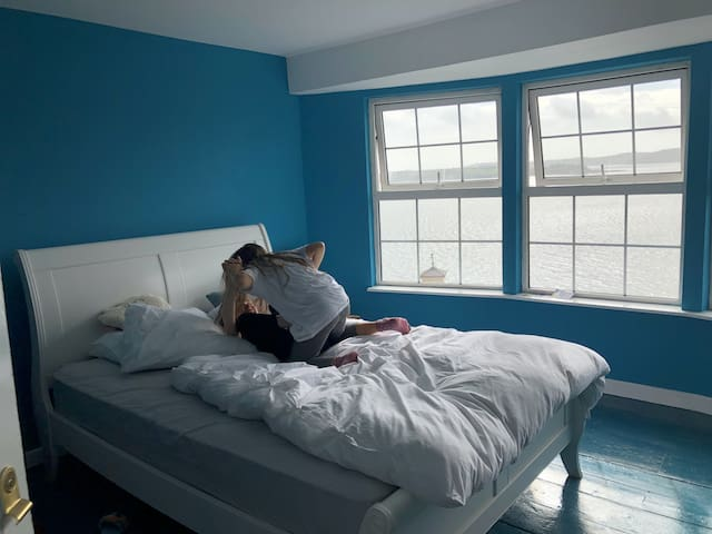 The third floor bedroom with its panoramic views over the harbour has a king size double bed as well as a single bed...