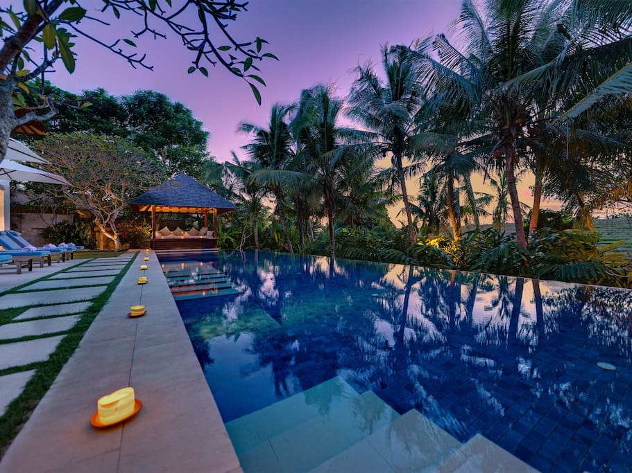 Spectacular views over cascading rice-terraces and a small jungle-clad river valley in a peaceful, traditional Balinese village within the sought-after Canggu area.