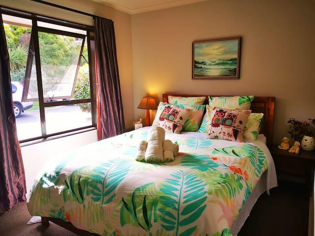 A warm bedroom with wardrobe