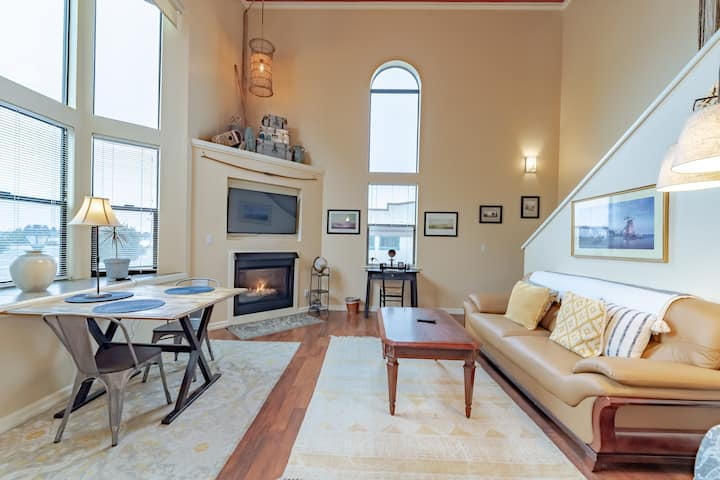 Fresh and new loft condo with views of the bay and right on the Boardwalk!