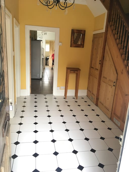 Large and square tiled entrance hall.