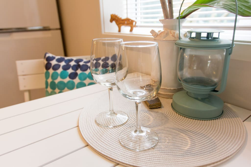 Unwind with a glass of wine after a long day at the beach.