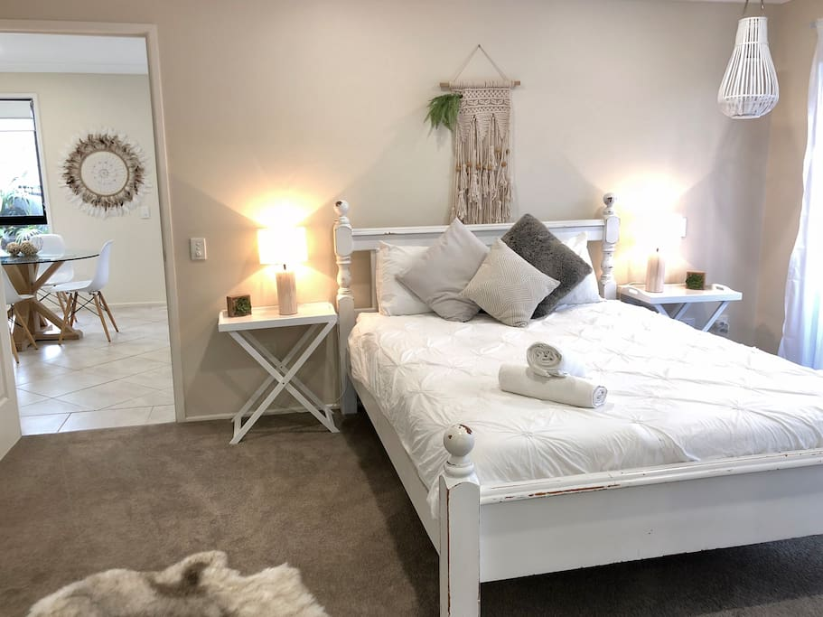 Warm and inviting bedroom through to living area :)