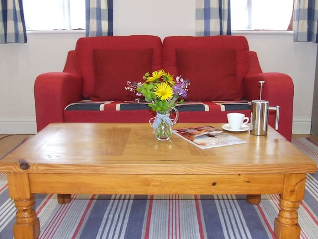 Lobhill Stable Cottage - Self Catering Holiday Home  - Cherry Red Sofa