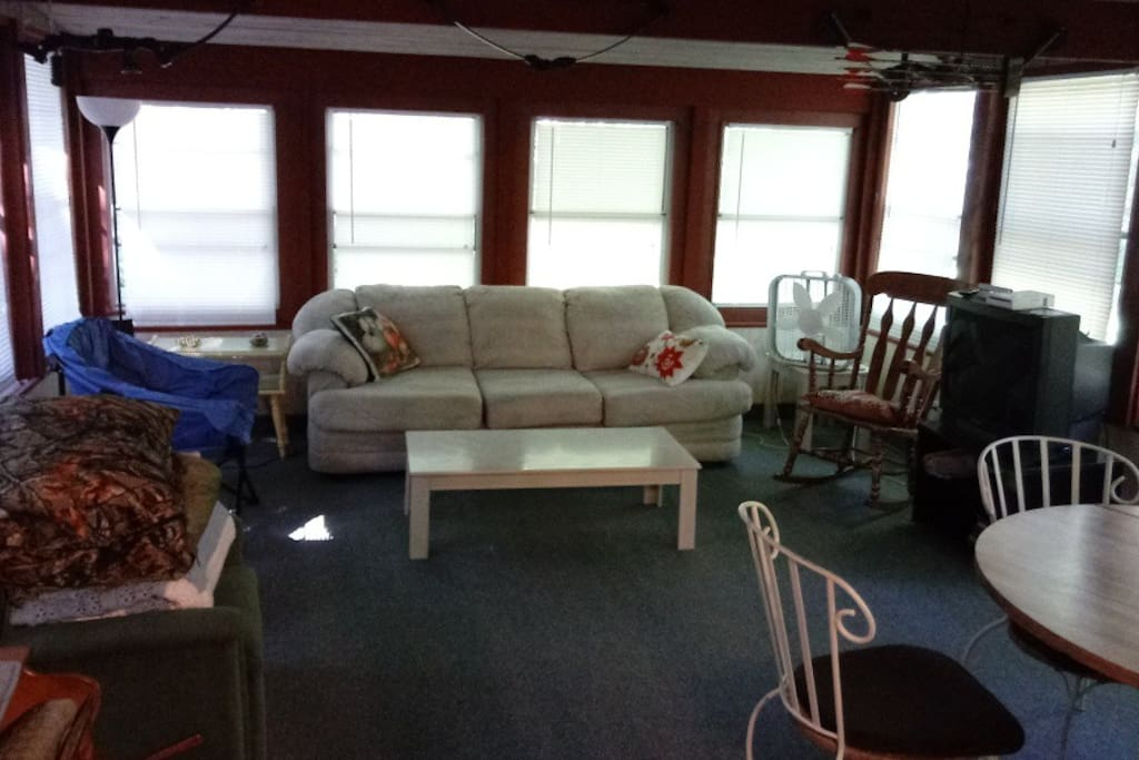 "Sun Room - very large sititng area, 27"" tv with cable, ample seating and table & chairs."