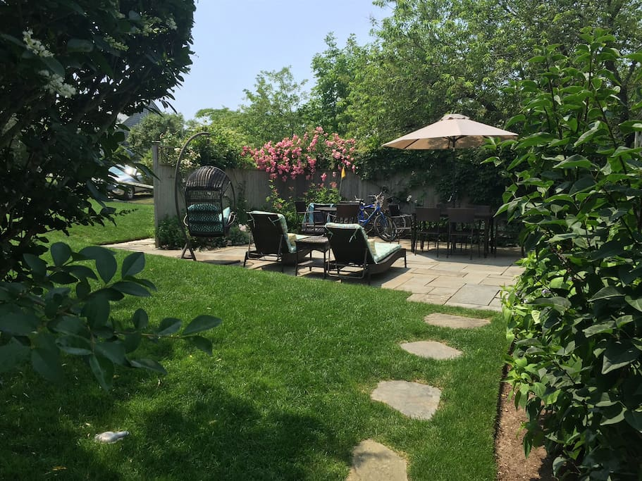 Back yard and large, private blue stone patio with grill.
