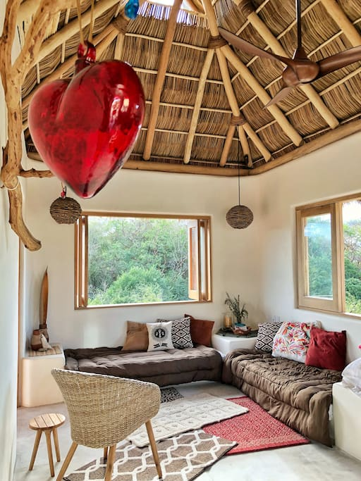 Enjoy the casual natural living area under a palapa roof.