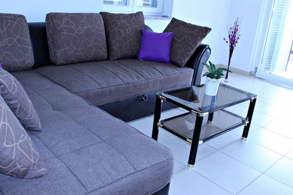 Living room with sofa for two and a table.