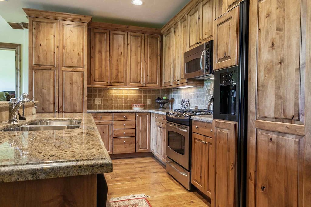 Enjoy creating meals in this fully equipped kitchen with granite countertops and stainless appliances.