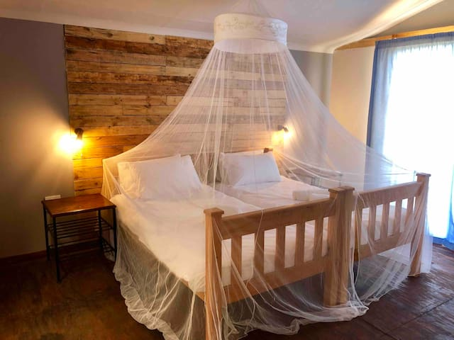 Bedroom with Mosquito net.