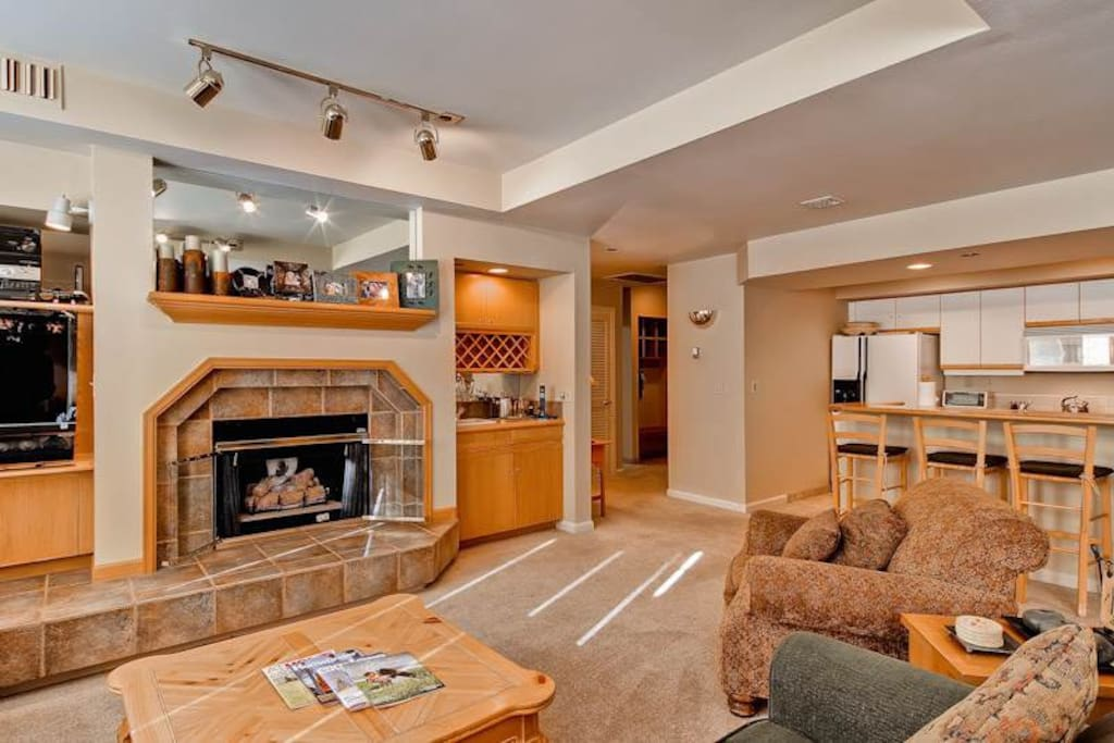 Couch,Furniture,Floor,Flooring,Fireplace
