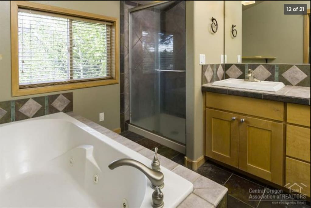 Master bath: huge tub, shower and two sinks