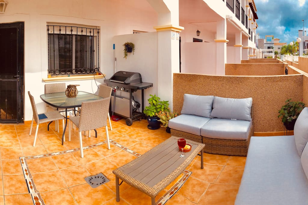 The bottom terrace also has a comfortable living and dining space.  Perfect for warm evenings!