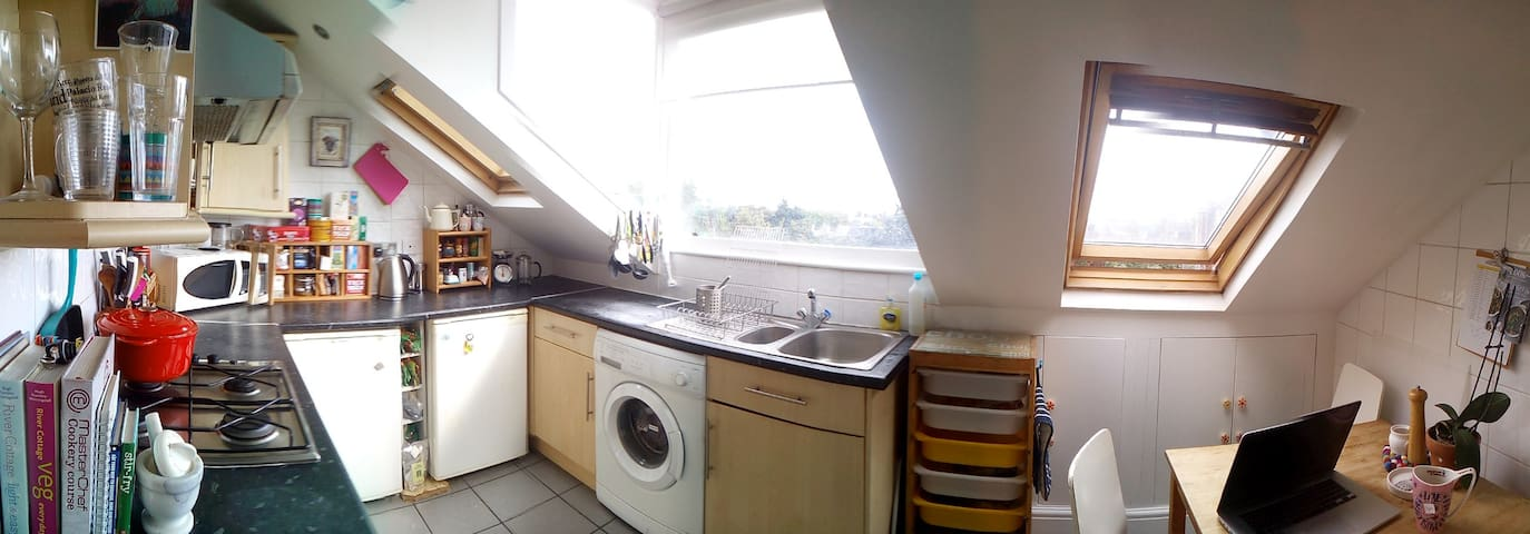 Small bright kitchen looks over the London Skyline