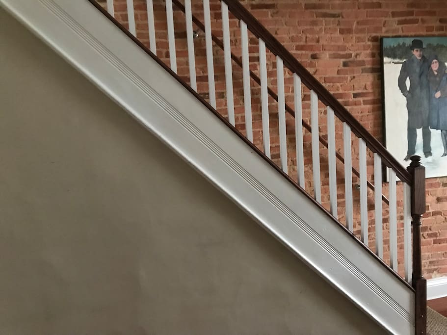 As of April 2018 we have had a railing installed on the main staircase.