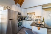 Newly remodeled full size kitchen with stainless steel appliances and dishwasher.