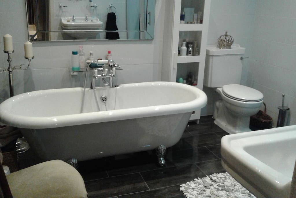 Bathroom with free standing bath and separate shower
