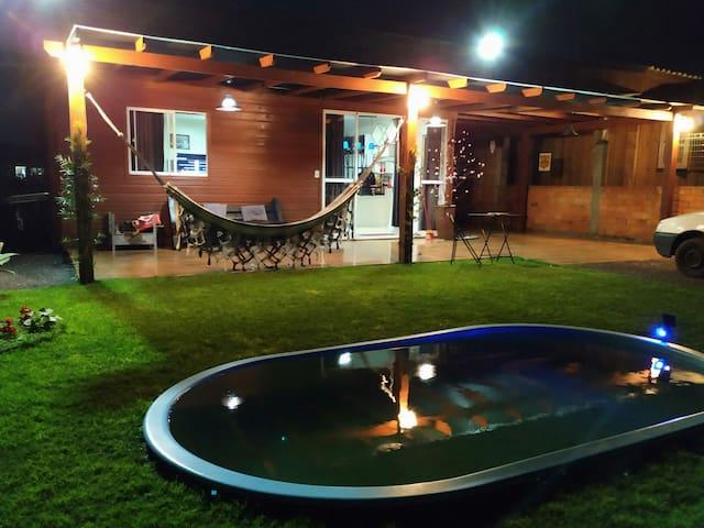 praia de torres,Casa com piscina 51992090267