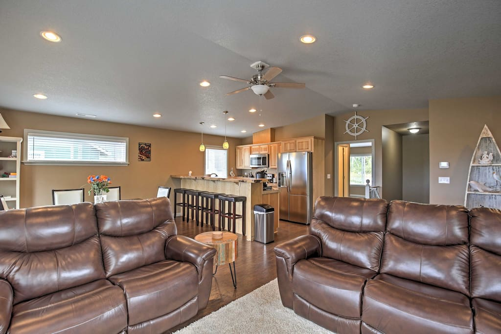 The well-appointed interior  features an open floor plan with a fully equipped kitchen, living room, and dining area.