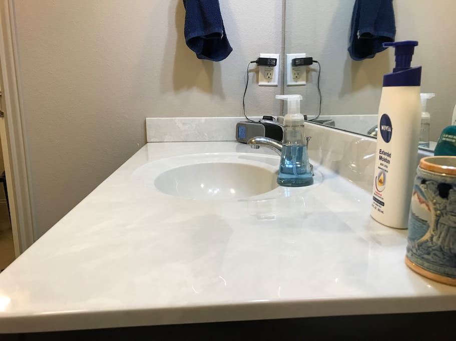 Clean bathroom counter, side view