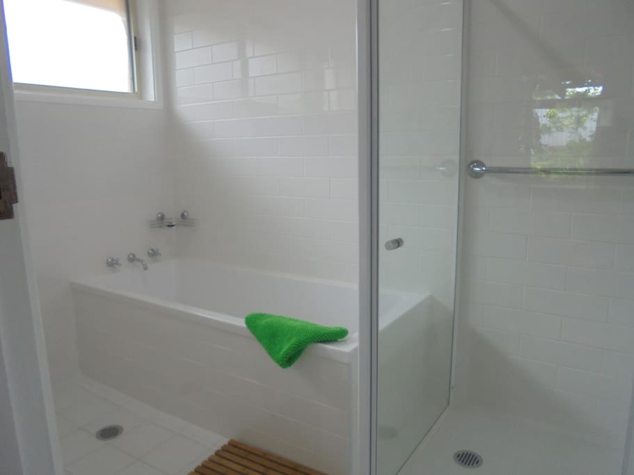 Bathroom with big bathtub - perfect for a soak after a day of bushwalking. Contains heated towel rail. There is a portable fan heater that can be used in here. Toilet is separate to bathroom.