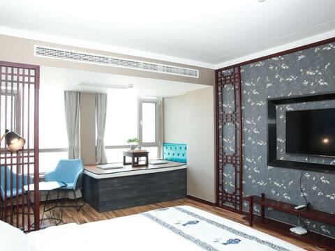 威海蜗牛公寓东海岸新中式大床房1