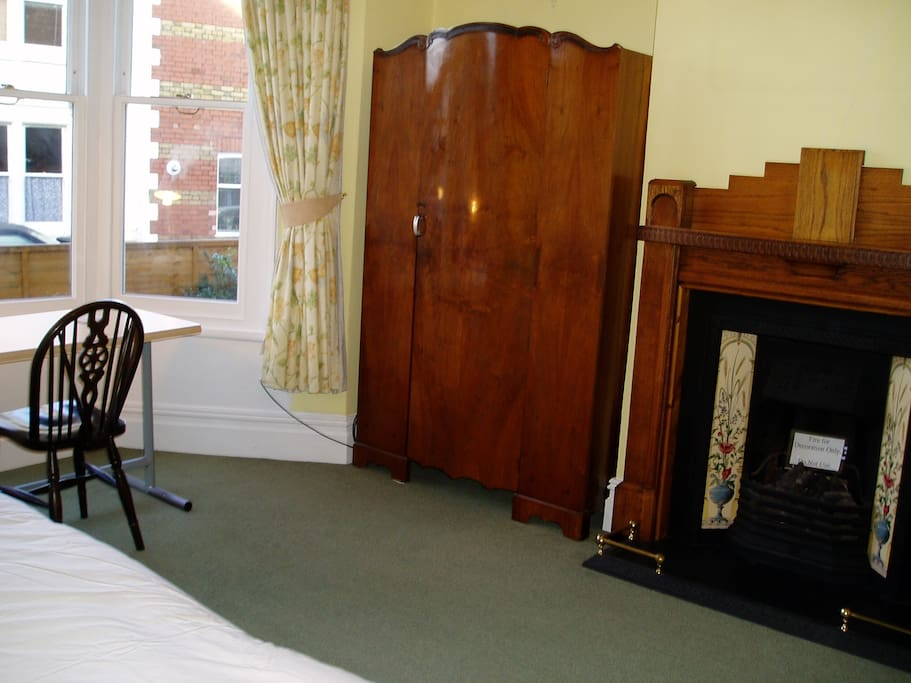 Lovely period furniture and fireplace.