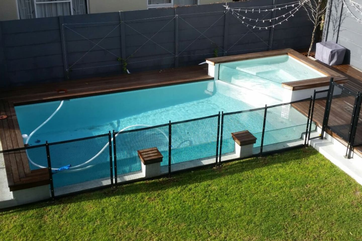 Pool with glass sides and top pool which works well to relax in or for smaller kids.