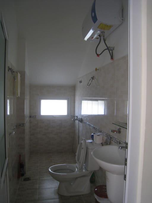 Toilet and shower inside top floor bedroom