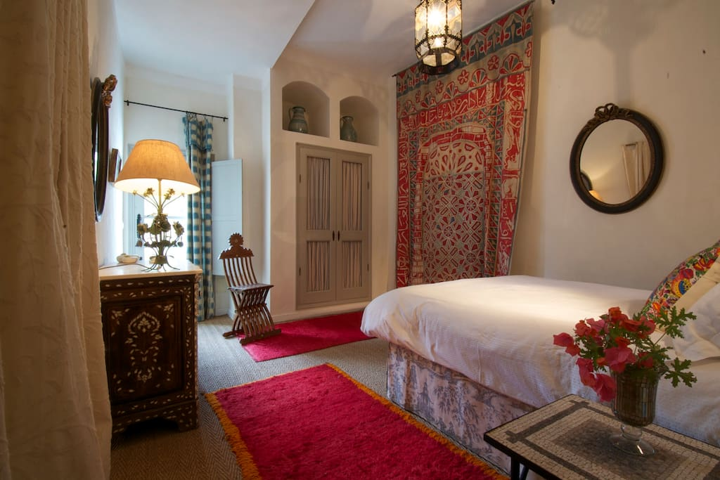 Master bedroom with door to swimming pool terrace.