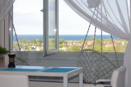 Romantisches Studio mit Meeresweitblick