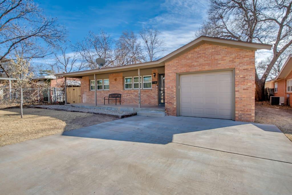 Large driveway. Single car garage