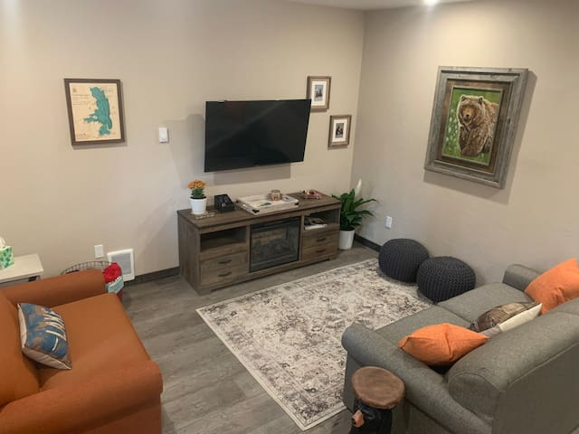 """55"""" tv w/spectrum cable on Apple TV app and an electric fireplace in living area. Full size sleeper and twin sleeper with upgraded memory foam mattresses."""