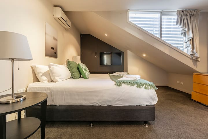 The master bedroom is fitted with a queen-sized bed, reverse cycle heating and cooling and abundant storage space for your belongings.