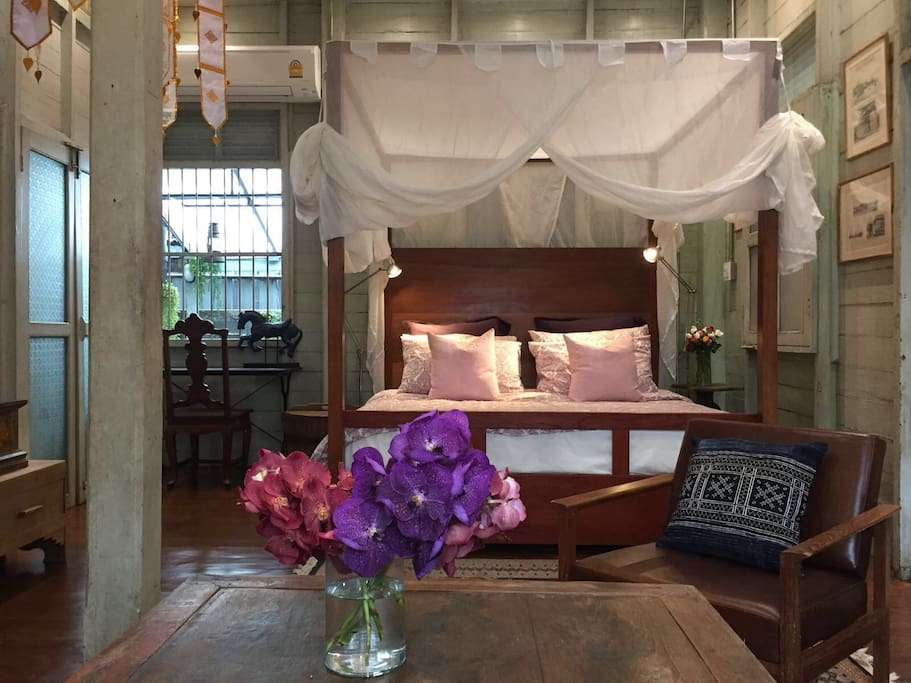 the main bedroom: l'explorateur suite. the theme is exploration. inside this suite you will find many old maps and travel inspirations.