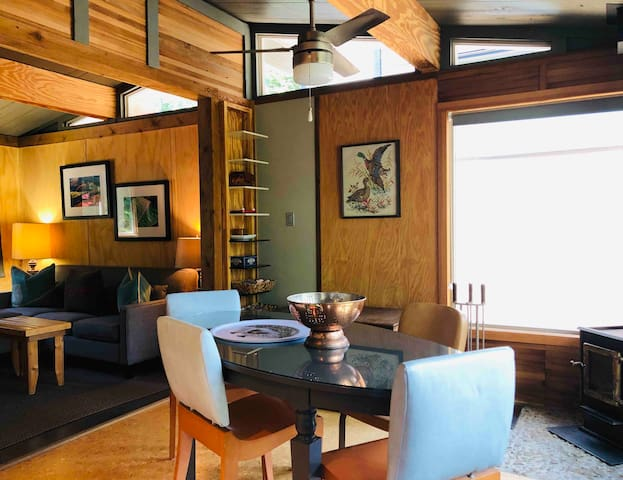 Treehouse Cottage dining area looking into cosy living room area