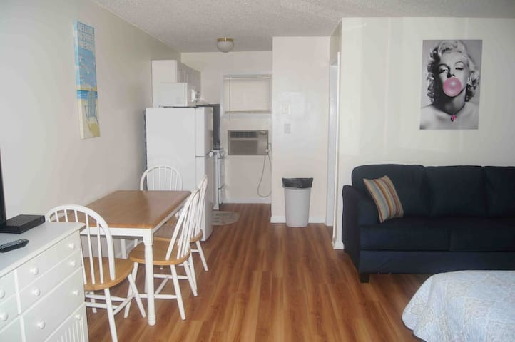 Adorable studio one block from beach with pool.