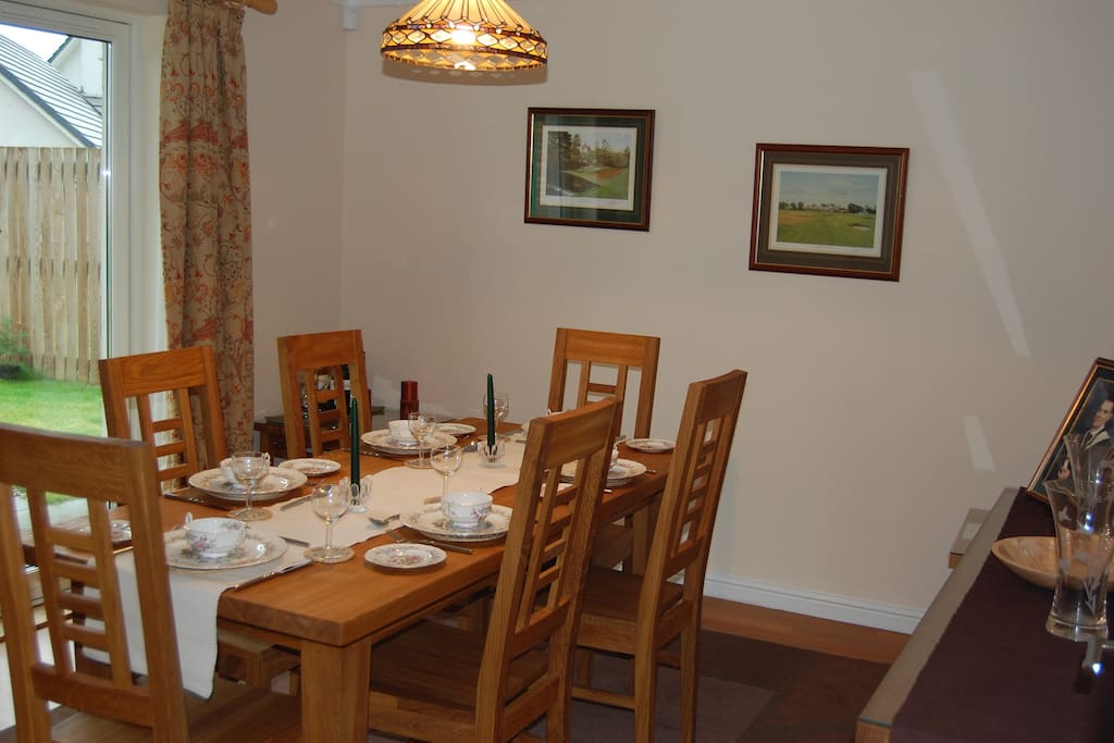 Dining room with patio doors on to enclosed back garden.