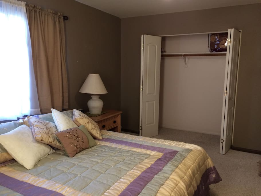 This is a different view on the bedroom.  It has great natural lighting.  The outer drapes are the room darkening type so can be closed if you want darker room during the day.  There is lots of closet space and hangers available.