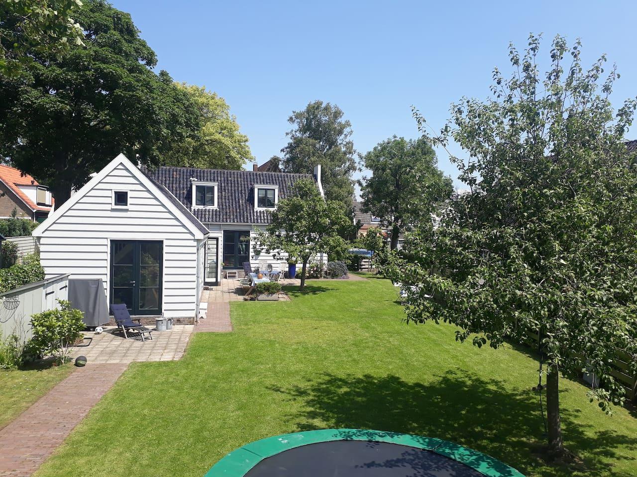 Wooden family house with spacious garden