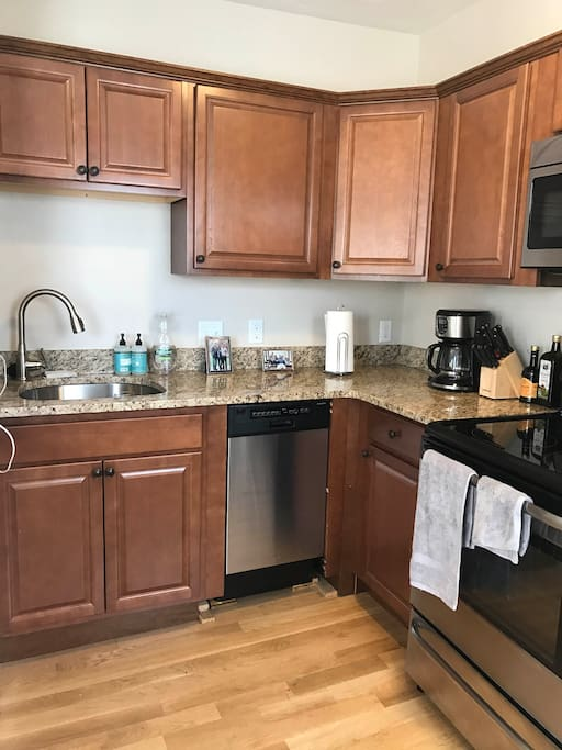 Brand new appliances, dishwasher, microwave, oven and stove.