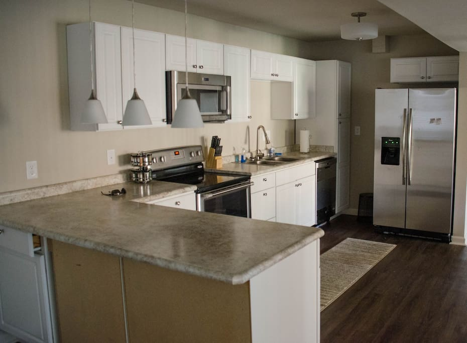 Large open kitchen, with a breakfast bar.