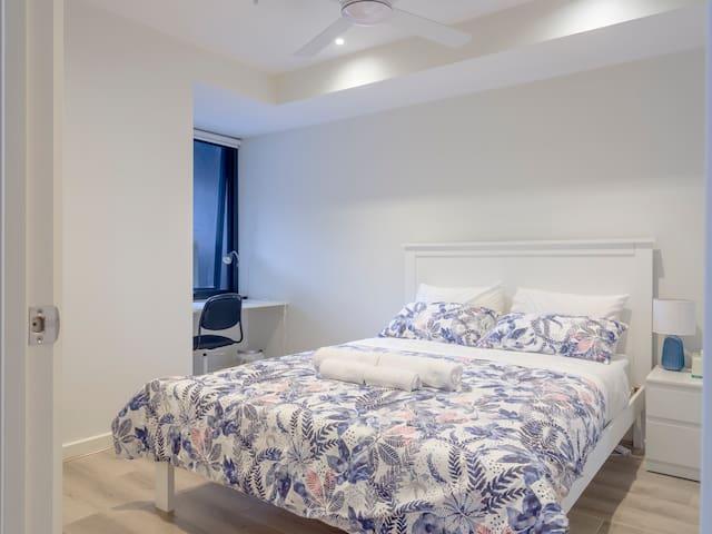 Main Bedroom, with Queen bed, Ceiling fan & Built in Study Desk