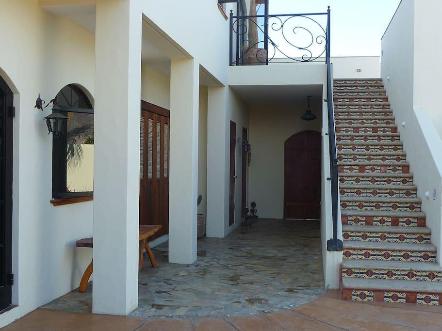 hallway from front door - staircase to upper level andmaster bedroom  - 2nd bedroom bottom left