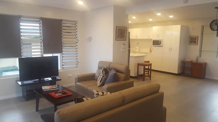Modern top floor air conditioned apartment.
