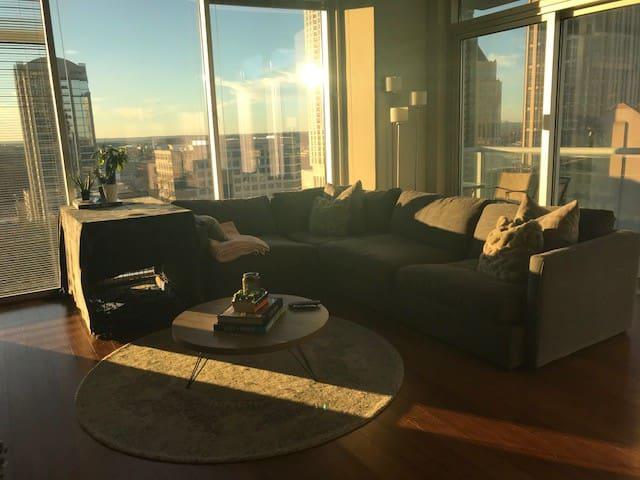 Huge, comfortable 'L' shape sofa, beautiful floor to ceiling windows