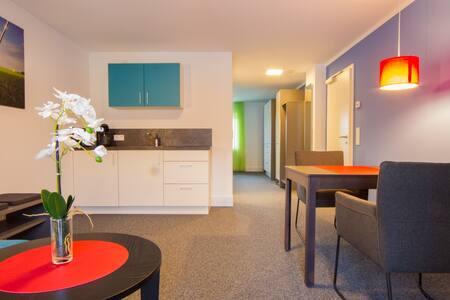 Appartements am Rindhof (Münnerstadt), Modernes Appartement 4 in ruhiger Lage mit traumhaftem Ausblick