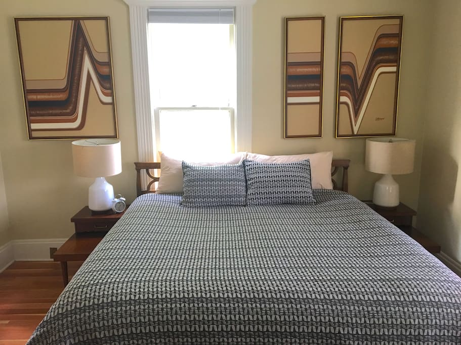 Window opens behind bed for air circulation