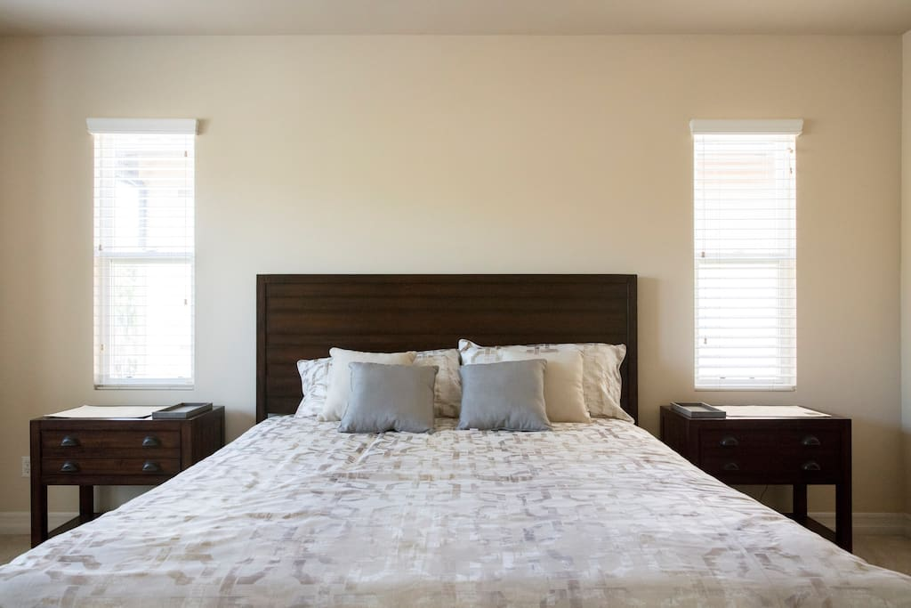 Spacious Master bedroom with King bed and Hotel Collection bedding. Nightstands have built in USB charging stations.