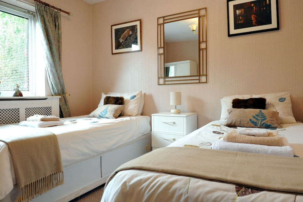 Bedroom 2 with twin beds. Ground floor with a bright front garden aspect.